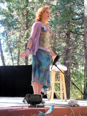 Not your typical corporate speaker: Giselle onstage at the Sierra Storytelling festival. Giselle has performed dozens of times as a storyteller and trained for 5 years with Rebecca Fisher and the Renegade Women troupe. She has appeared on stage at Burning Man five times, and to audiences at Porchlight, Tell it on Tuesday and many storytelling festivals.